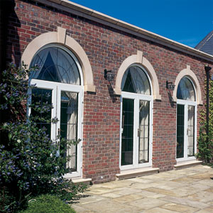 Complete arched frames with bespoke leaded glass.